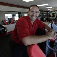 Photo -   In this June 14, 2012, photo, Rick Limitone, manager of Snap Fitness, posses for a photo at the truck stop gym in Dallas. From trucking companies embracing wellness and weight-loss programs to gyms being installed at truck stops, momentum has picked up in recent years to help those who make their living driving big rigs get into shape. (AP Photo/LM Otero)