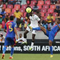 Photo - Ghana's John Boye, center, heads the ball as he defends against Cape Verde's Fernando Varela, right, and teammate Babanco