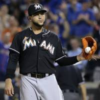 Photo - Miami Marlins pitcher Henderson Alvarez reacts after giving up a two-run home run to New York Mets' David Wright in the fifth inning of a baseball game, Friday, July 11, 2014, in New York. (AP Photo/Julie Jacobson)