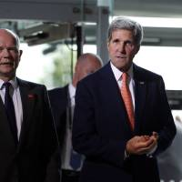 Photo - US Secretary of State John Kerry, right, and British Foreign Secretary William Hague, left, arrive at the 'End Sexual Violence in Conflict' summit in London, Friday, June 13, 2014. The Summit welcomed governments from over 100 countries, over 900 experts, NGOs, Faith leaders, and representatives from international organisations across the world. (AP Photo/Lefteris Pitarakis)
