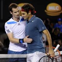 Photo - Roger Federer of Switzerland, right,  is congratulated by Andy Murray of Britain at the net after Federer won their quarterfinal at the Australian Open tennis championship in Melbourne, Australia, Wednesday, Jan. 22, 2014.(AP Photo/Andrew Brownbill)