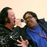 Photo -  Kim Randle, a client at Oklahoma Foundation for the Disabled, dances and sings with Elvis impersonator, Mike Black, during the grand opening of the new Impact Oklahoma Recreation Center at the Oklahoma Foundation for the Disabled in Oklahoma City on Tuesday, Jan. 18, 2011. Photo by John Clanton, The Oklahoman