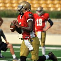 Photo - Notre Dame quarterback Everett Golson sprints out at practice during media day for the NCAA college football team Tuesday Aug. 19, 2014, in South Bend, Ind. (AP Photo/Joe Raymond)