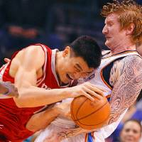 Photo - NBA BASKETBALL: Yao Ming runs up against Robert Swift in the first half as the Oklahoma City Thunder plays the Houston Rockets at the Ford Center in Oklahoma City, Okla. on Friday, January 9, 2009.   Photo by Steve Sisney/The Oklahoman ORG XMIT: kod Photo by Steve Sisney, The Oklahoman