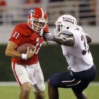 Photo -   Georgia quarterback Aaron Murray (11) breaks away from Florida Atlantic linebacker Cory Henry (31) in the second half of an NCAA college football game Saturday, Sept. 15, 2012, in Athens, Ga. (AP Photo/John Bazemore)