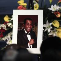Photo -   A portrait of the late boxing trainer Emanuel Steward is seen during his funeral service at the Greater Grace Temple in Detroit, Tuesday, Nov. 13, 2012. (AP Photo/Carlos Osorio)