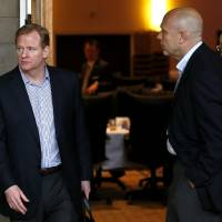 Photo - NFL Commissioner Roger Gooderll, left, walks with Miami Dolphins owner Stephen Ross, far right, and Dolphins CEO Mike Dee during the annual NFL footbal meetings at the Arizona Biltmore, Tuesday, March 19, 2013, in Phoenix. (AP Photo/Ross D. Franklin)