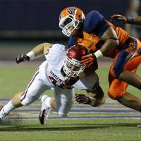 Photo - Oklahoma Sooners fullback Aaron Ripkowski (48) blocks UTEP Miners defensive lineman Roy Robertson (43) during the college football game between the University of Oklahoma Sooners (OU) and the University of Texas El Paso Miners (UTEP) at Sun Bowl Stadium on Saturday, Sept. 1, 2012, in El Paso, Texas.  Photo by Chris Landsberger, The Oklahoman