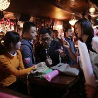 Photo -   Participants who are singles introduce themselves during a matchmaking party organized by one of the biggest Chinese matchmaking websites in Shanghai, China on Sunday Nov. 11, 2012. Singles Day was begun by Chinese college students in the 1990s as a version of Valentine's Day for people without romantic partners. The timing was based on the date Nov. 11, or