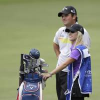 Photo - Defending champion Patrick Reed, back, waits with his wife and caddie, Justine, to hit on the sixth hole during the pro-am for the Wyndham Championship golf tournament in Greensboro, N.C., Wednesday, Aug. 13, 2014. (AP Photo/Chuck Burton)