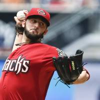 Photo - Arizona Diamondbacks starting pitcher Mike Bolsinger throws against the San Diego Padres during the first inning of a baseball game, Sunday, June 29, 2014, in San Diego.  (AP Photo/Lenny Ignelzi)