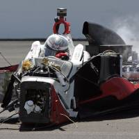 Photo - The car driven by Chase Austin comes to a rest after hitting wall in the first turn during the Indy Lights Freedom 100 auto race at the Indianapolis Motor Speedway in Indianapolis, Friday, May 23, 2014. (AP Photo/Joe Watts)