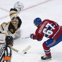 Photo - Boston Bruins goalie Tuukka Rask makes a save off Montreal Canadiens' Max Pacioretty during first period NHL hockey action Wednesday, March 12, 2014 in Montreal.  (AP Photo/The Canadian Press, Paul Chiasson)