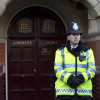 Photo - A policeman stands on duty outside Westminster Coroner's Court where the initial inquest into nurse Jacintha Saldanha's death is being opened, in London,Thursday, Dec. 13, 2012. Saldanha, the nurse who passed a hoax call into the hospital room of the pregnant Duchess of Cambridge, apparently killed herself three days later, with a coroner's officer saying Tuesday she was found hanging by the neck and a detective saying she left three notes. (AP Photo/Alastair Grant)