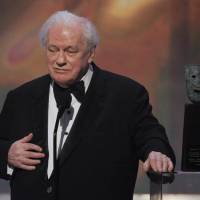 Photo - FILE - In this Sunday, Jan. 27, 2008 file photo, in Los Angeles file photo, actor Charles Durning accepts the life achievement award at the 14th Annual Screen Actors Guild Awards. Durning, the two-time Oscar nominee who was dubbed the king of the character actors for his skill in playing everything from a Nazi colonel to the pope, died Monday, Dec. 24, 2012 at his home in New York City. He was 89. (AP Photo/Mark J. Terrill)