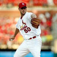 Photo - St. Louis Cardinals starting pitcher Adam Wainwright  throws during the first inning of a baseball game against the Arizona Diamondbacks Tuesday, May 20, 2014, in St. Louis. (AP Photo/Scott Kane)