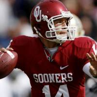 Photo - OU quarterback Sam  Bradford looks downfield during the first half of Saturday's game against Baylor. Photo by Chris Landsberger, The Oklahoman.