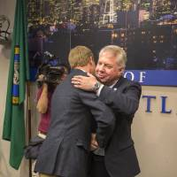 Photo - Seattle Mayor Ed Murray, right, is congratulated after announcing his proposed phased-in increase of the city's minimum wage to $15 an hour over the next seven years, Thursday, May 1, 2014 in Seattle. (AP Photo/The Seattle Times, Steve Ringman)   SEATTLE OUT; USA TODAY OUT; MAGS OUT; TELEVISION OUT; NO SALES; MANDATORY CREDIT TO BOTH THE SEATTLE TIMES AND THE PHOTOGRAPHER
