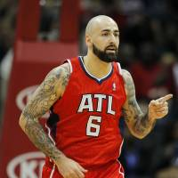 Photo - Atlanta Hawks center Pero Antic (6) reacts after a score in the first period of an NBA basketball game against the Miami Heat in Atlanta, Monday, Jan. 20, 2014. (AP Photo/Todd Kirkland)