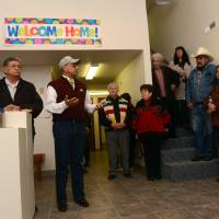 Photo -   FILE - In this Saturday, Nov. 3, 2012 file photo, Henry Anderson, left, and James Parker Shield welcome people to the new Little Shell Chippewa Cree Visitor Center in Montana. Montana's Little Shell tribe appeared poised to fade from history in recent years after it was denied federal government recognition, lost its financial support from the state and saw its elected leadership splinter. But the past year has brought a sharp turnaround for the 4,500-member landless tribe that long has existed on society's fringe. Tribal enrollment is on the rise. Government grant money is flowing again, and the Little Shell cultural and visitor center opened this month in Great Falls. (AP Photo/The Great Falls Tribune, Rion Sanders) NO SALES