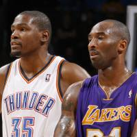 Photo - L.A. LAKERS: Oklahoma City's Kevin Durant (35) stands next to Los Angeles' Kobe Bryant (24) during an NBA basketball game between the Oklahoma City Thunder and the Los Angeles Lakers at Chesapeake Energy Arena in Oklahoma City, Thursday, Feb. 23, 2012. Photo by Bryan Terry, The Oklahoman