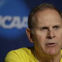 Photo - Michigan head coach John Beilein speaks during a news conference for the third-round game of the NCAA college basketball tournament Friday, March 21, 2014, in Milwaukee. Michigan plays Texas on Saturday. (AP Photo/Morry Gash)