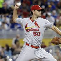 Photo - St. Louis Cardinals starting pitcher Adam Wainwright throws in the first inning during a baseball game against the Miami Marlins, Tuesday, Aug. 12, 2014, in Miami. (AP Photo/Lynne Sladky)