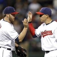 Photo - Cleveland Indians relief pitcher Cody Allen, left, celebrates with Asdrubal Cabrera after the Indians' 5-2 win over the Colorado Rockies in a baseball game Friday, May 30, 2014, in Cleveland. (AP Photo/Mark Duncan)