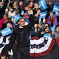 Photo -   In the final hours of a four-state campaign day, President Barack Obama arrives at a rally at Jiffy Lube Live arena, late Saturday night, Nov. 3, 2012, in Bristow, Va. Virginia is one of the most closely contested battleground states. (AP Photo/J. Scott Applewhite)
