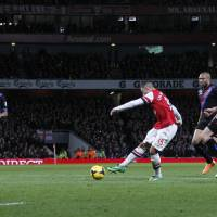 Photo - Arsenal's Alex Oxlade-Chamberlain, third right, scores his second goal against Crystal Palace during their English Premier League soccer match at Emirates Stadium in London, Sunday, Feb. 2, 2014. (AP Photo/Sang Tan)