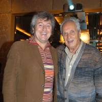 Photo - In this photo taken on Nov. 23, 2004 Vittorio Missoni, left, and his father Ottavio smile in Milan, Italy. The search resumed Saturday, Jan. 5, 2013 for a small plane that has disappeared off the Venezuelan coast with six people aboard, including Vittorio Missoni, a top executive in Italy's Missoni fashion house, officials said. Vittorio Missoni, 58, is the director general of the iconic brand and the eldest son of the company's founder. Flying with him on Friday's flight from Venezuela's Los Roques resort archipelago to Caracas, was Missoni's wife, Maurizia Castiglioni, two Italian friends of the couple, and a crew of two Venezuelans. (AP Photo/Livio Valerio, Lapresse)