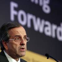Photo -   FILE - In this Monday, Oct. 15, 2012 file photo shows Greece's Prime Minister Antonis Samaras delivers a speech in a forum of International Herald Tribune in Athens. Samaras said on Tuesday, Oct. 30, 2012 that the government had essentially ended negotiations on new austerity measures and warned of