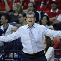 Photo - Connecticut head coach Geno Auriemma reacts to play during the first half of an NCAA college basketball game against Rutgers, Sunday, Jan. 19, 2014, in Piscataway, N.J. Connecticut won 94-64. (AP Photo/Mel Evans)