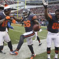 Photo -   FILE - In this Oct. 28, 2012, file photo, Chicago Bears cornerback Tim Jennings (26) celebrates with teammates Brandon Marshall (15) and Earl Bennett (80) after he returned and interception for a touchdown during the second half of an NFL football game against the Carolina Panthers in Chicago. The Bears has seven interception returns for touchdowns and eight scores on defense this season. (AP Photo/Nam Y. Huh, File)
