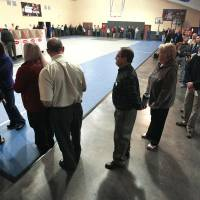 Photo - A line of voters winds around a gymnasium Tuesday at Precinct 137 in  Oklahoma City.  Photo by  Paul B. Southerland, The Oklahoman