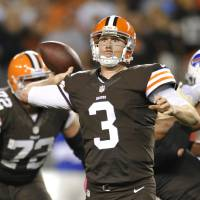 Photo -  Cleveland Browns quarterback Brandon Weeden passes against the Buffalo Bills in the fourth quarter of an NFL football game Thursday, Oct. 3, 2013, in Cleveland. Weeden took over for starter Brian Hoyer who was injured in the first quarter. (AP Photo/David Richard)