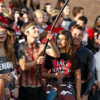 Photo - Westmoore fan Ashton Bishop waves a flag as Westmoore plays Moore High School on Sept. 6.  Photo by Steve Sisney, The Oklahoman  STEVE SISNEY - THE OKLAHOMAN