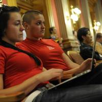 Photo -   Mandalyn Starkovich, left, and Kristen Marshall wait for a hearing on Senate Bill 2 to come up in front of the House Judiciary Committee at the State Capitol in Denver, Thursday, May 3, 2012. The Colorado Civil Union Act recently passed the Senate with bipartisan support. The bill would allow same sex couple to enter into civil union. (AP Photo/The Denver Post, Craig F. Walker) MAGS OUT; TV OUT; INTERNET OUT