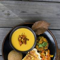 Photo - A vegetarian Thanksgiving dinner of red bell pepper and apple slaw, no knead flax rolls, roasted vegetable quiche, corn bread stuffing mushrooms and squash bisque with pan roasted corn salsa is shown served on a table in Concord, N.H. AP PHOTO  Matthew Mead - AP