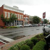 Photo - The Downtown Norman Historic District is among 17 places named to the National Register of Historic Places in 2011-2012. This view shows the 100 Block of East Main Street.  STEVE SISNEY - The Oklahoman