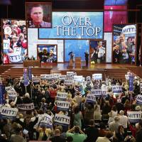 Photo - Delegates celebrate Tuesday, Aug. 28, 2012, after presidential candidate Mitt Romney receives enough votes to receive the GOP nomination during the Republican National Convention in Tampa, Fla. AP Photo  J. Scott Applewhite - AP
