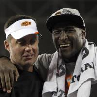 Photo - COLLEGE FOOTBALL / CELEBRATION: Oklahoma State head coach Mike Gundy and Justin Blackmon celebrate the Fiesta Bowl between the Oklahoma State University Cowboys (OSU) and the Stanford Cardinals at the University of Phoenix Stadium in Glendale, Ariz., Tuesday, Jan. 3, 2012. Photo by Sarah Phipps, The Oklahoman