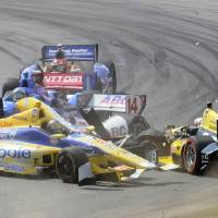 Photo - Marco Andretti (25) collides with Tony Kanaan (10), of Brazil, in a first lap crash during the IndyCar Honda Indy 200 auto racing at Mid-Ohio Sports Car Course in Lexington, Ohio Sunday, Aug. 3, 2014, while Takuma Sato (14), of Japan, and Ryan Briscoe (8), of Australia, try to avoid the crash. (AP Photo/Tom E. Puskar)