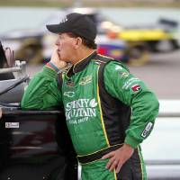 Photo -   Ron Hornaday Jr. waits to drive qualifying laps for the NASCAR Trucks Series auto race, Friday, Nov. 16 2012 at the Homestead-Miami Speedway in Homestead, Fla. (AP Photo/Terry Renna)