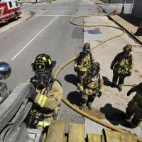 Photo - Oklahoma City firefighters train in a realistic setting.  Jim Beckel - THE OKLAHOMAN