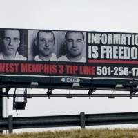 Photo - A billboard pleads the case of the