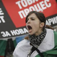 Photo - A Bulgarian woman shout slogans during a protest against higher electricity and heating bills, in Sofia,  Sunday, Feb. 17, 2013. Thousands of angry Bulgarians chanted