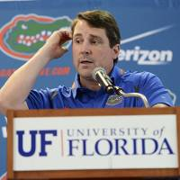 Photo - FILE - In this Aug, 3, 2014, file photo, Florida head football coach Will Muschamp fields questions from the media during an NCAA college football Media Day, in Gainesville, Fla. Coaches often say they are always on the hot seat. That might be true, but some seats are hotter than others. A few coaches in high-profile positions heading into 2014 very much in need of winning records and quality victories. (AP Photo/Phil Sandlin, File)
