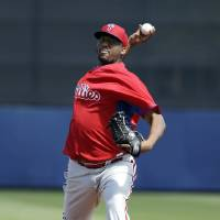 Photo - Philadelphia Phillies pitcher Roberto Hernandez delivers a warm-up throw in the first inning an exhibition baseball game against the Tampa Bay Rays, Monday, March 3, 2014, in Port Charlotte, Fla. (AP Photo/Steven Senne)
