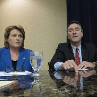 Photo -   Democratic U.S. Senate candidate Heidi Heitkamp, left, listens to Republican opponent Rick Berg, right, speak at a North Dakota Chamber of Commerce forum on health care and energy at a hotel in Bismarck, N.D., on Thursday, Oct. 11, 2012. A recent poll put the two candidates in a dead heat three weeks before the election. A Berg victory is crucial to Republican hopes of gaining control of the U.S. Senate. (AP Photo/Dale Wetzel)